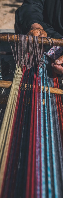 Bedouin woman working the ground loom